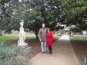 with my husband, next to a magnolia tree